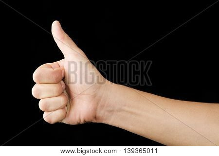 a hand with a thumb up with black background