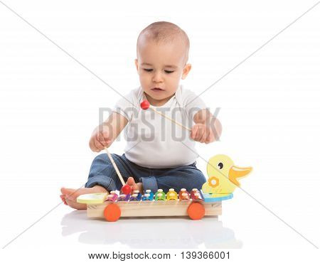 Baby enjoy in rhythm music isolated, close up