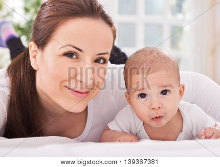 Relaxing Mother With Baby At Home