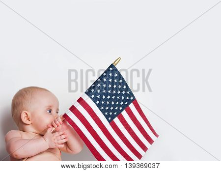 Adorable Baby Girl Holding An American Flag On White Background With Copy Space
