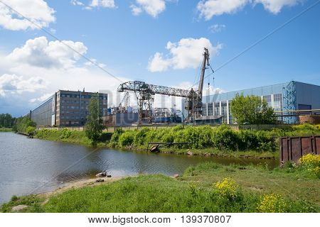 SHLISSELBURG, RUSSIA - JUNE 05, 2016: View of the Nevsky shipbuilding factory, sunny june day. The main landmark of the city Shlisselburg