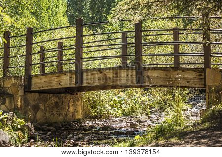 Small fairytale bridge with creek in Vail, Colorado during summer
