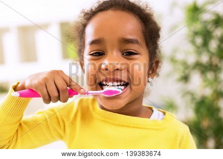 Little Beautiful African Girl Brushing Teeth