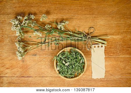 Yarrow.Dried herbs for use in alternative medicine.Herbal medicine phytotherapy medicinal herbs.For preparation of infusions decoctions tinctures powders ointments tea.Background green cloth