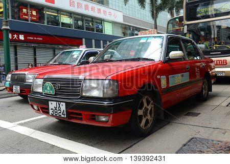 HONG KONG - NOV 10: Hong Kong Urban red Toyota Crown Confort YXS10 four seats taxi on Nov 10, 2015 in Hong Kong Island.