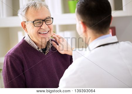Smiling happy old patient visit doctor, close up