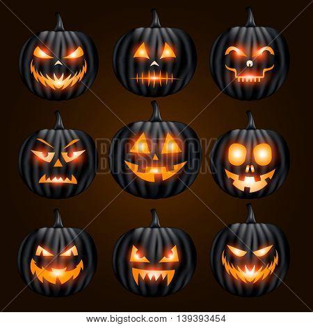 Jack o lantern pumpkin faces glowing on black background
