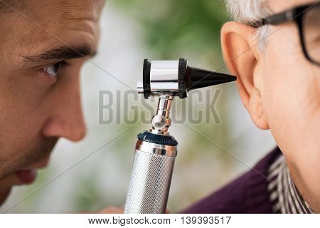 Doctor Performs An Ear Examination