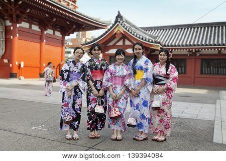 TOKYO - CIRCA JUNE, 2016: Japsnese teenage girls in kimonos at Sensoji-ji Red Japanese Temple in Asakusa, Tokyo, Japan