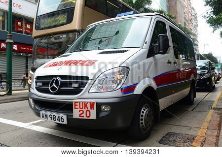 HONG KONG - NOV 10: Hong Kong police vehicle on duty on Nathan Road on Nov 10, 2015 in Kowloon, Hong Kong. The Mercedes-Benz Sprinter van is the most commonly seen police vehicles in Hong Kong.