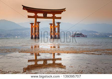MIYAJIMA, JAPAN - famous floating torii gate of the Itsukushima Shrine on Miyajima at sunset