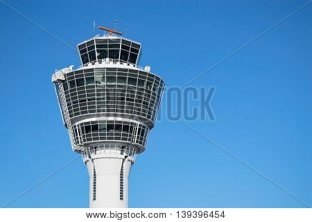 Munich air traffic control tower in airport with clear blue sky and free copy-space place for your text