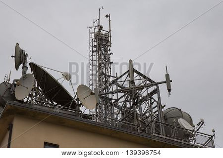 Trellis for mobile phone antennas on a building
