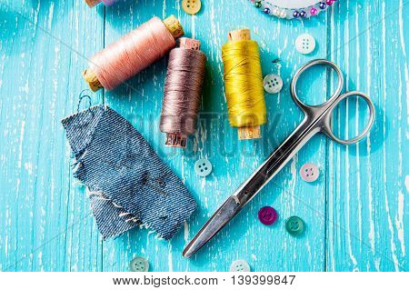 Set for sewing and needlework on a wooden board in Shabby Chic style - thread seam ripper scissors buttons pins poster