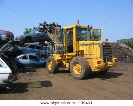 A Truck Lifting A Car Wreck