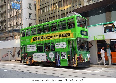 HONG KONG - NOV 9, 2015: Hong Kong double deck tram #169 on Des Voeux Road Central near Pottinger Street in Hong Kong Island, Hong Kong. Hong Kong Tramways have over 110 years history.