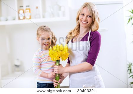 Beautiful Girl Giving Flowers For Mothers Day
