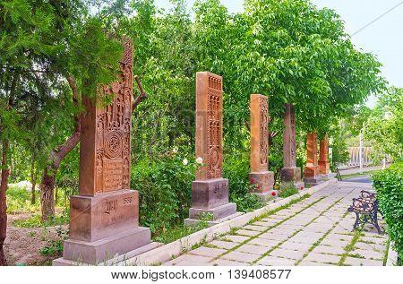 YEREVAN ARMENIA - MAY 29 2016: The Khachkar alley located in St John the Baptist Church garden on May 29 in Yerevan.