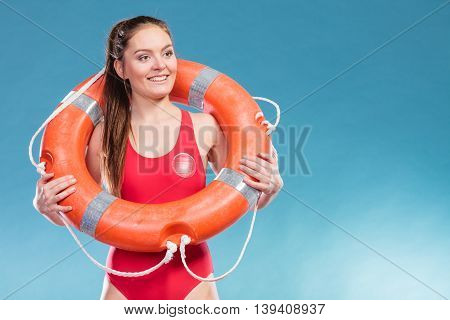 Lifeguard woman girl with ring buoy lifebuoy supervising.