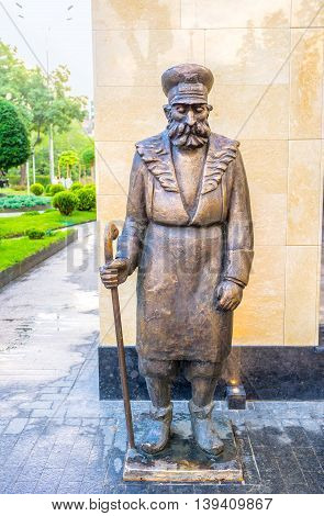 TBILISI GEORGIA - MAY 28 2016: The sculpture of the janitor - Kurd Rashid Adamov performed in accordance with a picture of the famous Georgian artist Niko Pirosmani on May 28 in Tbilisi.
