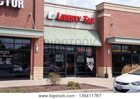 SHOREWOOD, ILLINOIS / UNITED STATES - AUGUST 30, 2015: One may have one's income tax returns prepared and filed at Liberty Tax, in a Shorewood strip mall.