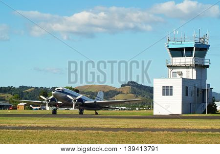 Vintage DC3 plane and control tower at Ardmore airfield, Auckland, New Zealand