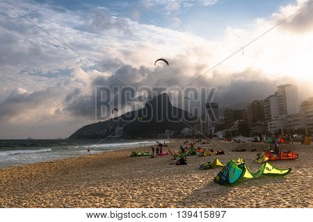 Rio de Janeiro, Brazil - July 16, 2016: Group of kite surfers enjoy windy day in Ipanema beach.