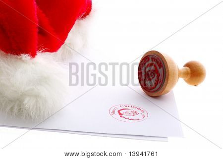 Merry christmas rubber stamp near red hat