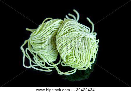 Jade noodle vegetable noodles green noodles on Black background.