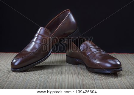 Footwear Concepts. Pair of Stylish Modern Calf Leather Brown Penny Loafers Shoes.Closeup Shot. Horizontal Image Orientation