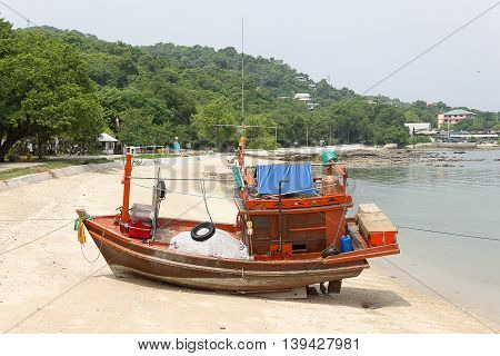 Fishing boats stranded on the beach due to low tide of sea water