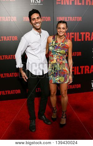NEW YORK-JULY 11: Nev Schulman (L) and girlfriend Laura Perlongo attend 'The Infiltrator' New York premiere at AMC Loews Lincoln Square 13 Theater on July 11, 2016 in New York City.