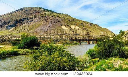 Railway Bridge over the Nicola River where it flows into the Thompson River at Spences Bridge in British Columbia