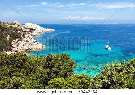 Aerial view of lonely yacht at Capo Testa beach Sardinia Italy