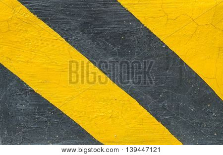 Closeup surface of old yellow and black painted cement floor texture background sign for let car know this area not allow for parking