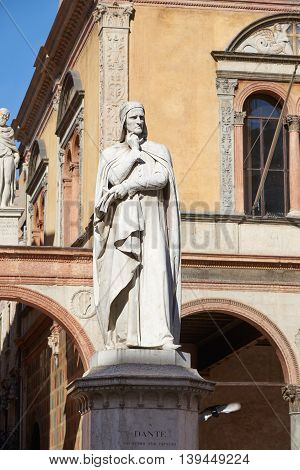 Verona Italy - Febuary 20 2016: Monument to Dante in Piazza dei Signori which is a city square located in the historic center of Verona. Dante was a major Italian poet of the late Middle Ages.