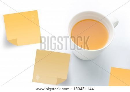 orange juice with post it paper on isolated white background