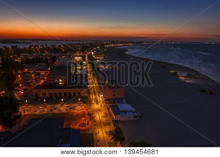 Sunset at seaside in Mamaia Romania. Sunset landscape in Mamaia Romania. Aerial view on sunset in Mamaia Romania.