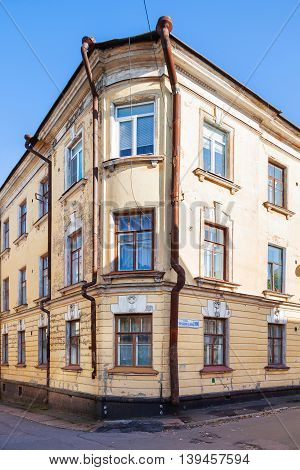 Old house in Vyborg Russia. Building with old fashioned windows and downpipes.