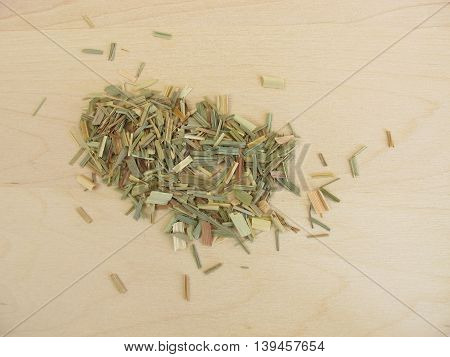 Dried lemon grass for tea on wooden board
