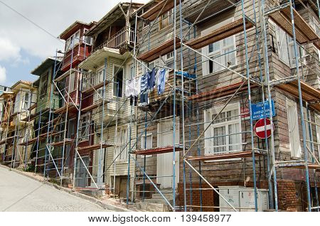 ISTANBUL TURKEY - JUNE 5 2016: Historic wooden homes being renovated in the Western suburb Edirnekape in Istanbul.
