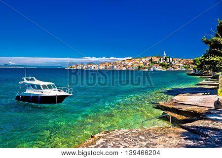 Kali beach and boat on turquoise sea Island of Ugljan Croatia