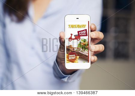 takeaway food service in a mobile phone service. Woman holding smartphone in the hand.