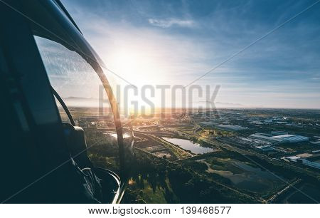 Aerial view of cape town city with bright sunshine from a helicopter.