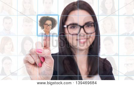 job search and career concept - woman pressing an imaginary buttons with business people portraits over white