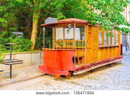 The vintage tram wagon converted into cozy cafe in the old town of Tbilisi Georgia.