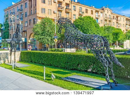 YEREVAN ARMENIA - MAY 29 2016: The impressive sculpture of two horses made of horseshoes in motin lcated in Cafesjian sculpture garden on May 29 in Yerevan.