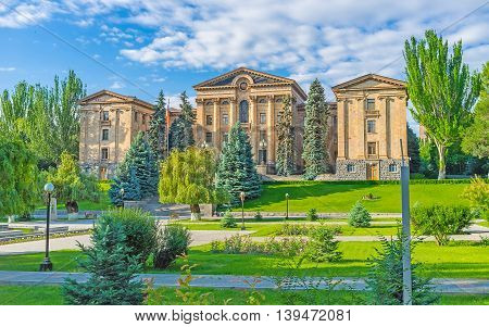 The building of National Assembly of Armenia (Parliament) surrounded by large garden Yerevan Armenia. poster