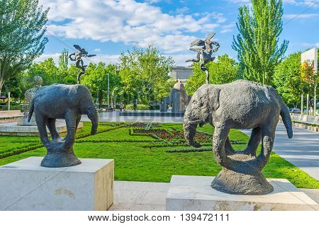 YEREVAN ARMENIA - MAY 29 2016: The Tamanyan street is famous for the sculpture garden containing modern art works of different sculptors on May 29 in Yerevan.