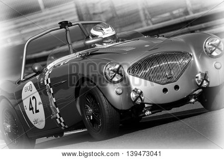 LE MANS FRANCE July 9 2016 : Old racing car at Indianapolis bend during Le Mans Classic on the circuit of the 24 hours. No other event in the world assembles so many old racing cars in the same place.